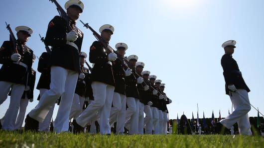 Members of the U.S. Marines march on the parade field during a ceremony to honor POW and MIA's at the Pentagon, September 20, 2013 in Arlington, Virginia.