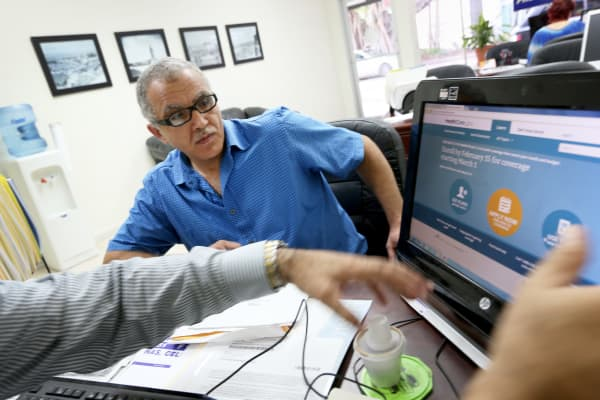 Hisham Uadadeh enrolls in a health insurance plan under the Affordable Care Act on Feb. 13, 2014, in Miami.
