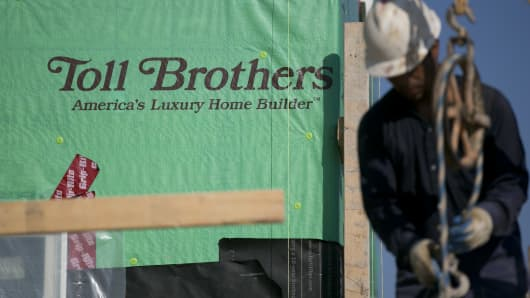 he Toll Brothers Inc. logo is seen on Pactiv Corp.'s GreenGuard MAX building wrap as a contractor works at the Cattail Overlook development in Glenelg, Maryland.