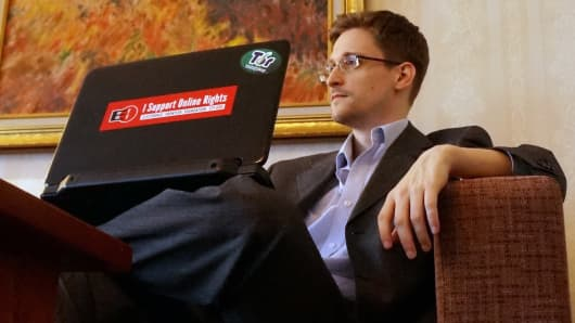Edward Snowden poses for a photo during an interview in an undisclosed location in December 2013 in Moscow.