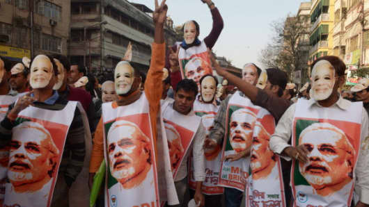 Bharatiya Janata Party (BJP) activists, clad in masks of BJP prime ministerial candidate and Gujarat state Chief Minister Narendra Modi, participate in a rally.