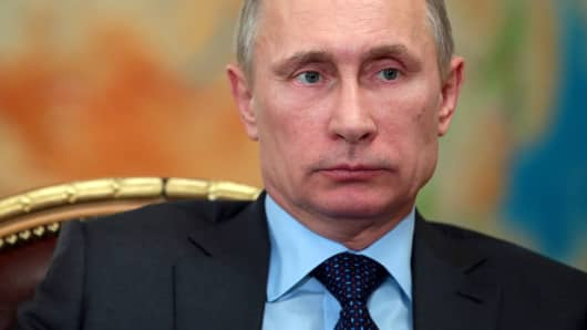 Vladimir Putin attends a meeting outside Moscow on February 26, 2014.