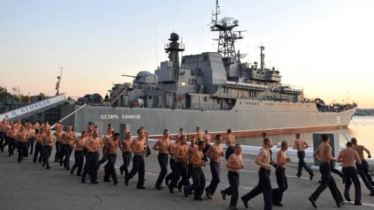 Russian sailors do their morning exercises near a navy vessel in the bay of the Ukrainian city of Sevastopol, the main base of the Russian Black Sea Fleet, in September 2011.