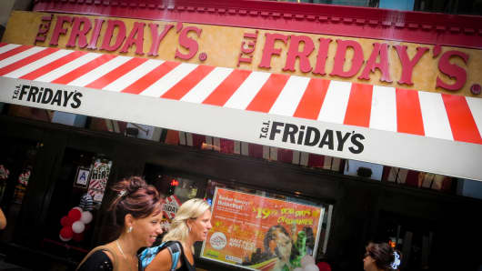 Pedestrians walk past a T.G.I. Friday's in New York.
