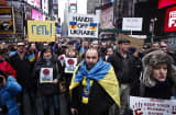 People take part during a protest in Times Square against Russian military intervention in the Crimea region of Ukraine, on March 2, 2014, in New York City.