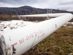 A section of the Bratstvo gas pipeline emerges from underground near Ivano-Frankvisk, Ukraine, Feb. 6, 2014.