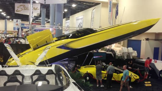 Marine Technology displays its floating Aventador, and the yellow Lamborghini that inspired it, at the Miami Boat Show.