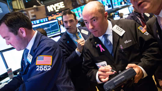 Traders work on the floor of the New York Stock Exchange on the afternoon of March 4, 2014.