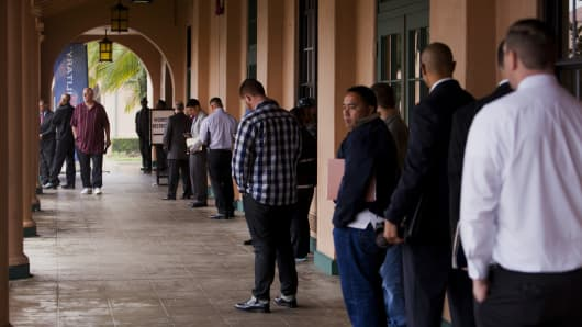 Job seekers line up for the Recruit Military veteran job fair in San Diego, California.