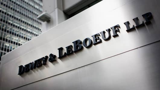 The Dewey & LeBoeuf LLP logo is displayed in front of the company's offices in New York,  May 3, 2012.
