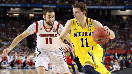 Nik Stauskas #11 of the Michigan Wolverines drives against Luke Hancock #11 of the Louisville Cardinals during the 2013 NCAA Men's Final Four Championship at the Georgia Dome, April 8, 2013 in Atlanta.