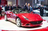 Ferrari Chairman Luca Cordero di Montezemolo presents the Ferrari California T during the 84th International Motor Show on March 4, 2014, in Geneva.