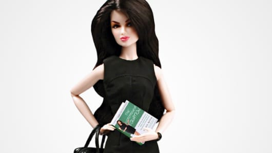 "Carol Roth has her own doll, which comes with a leather-style briefcase purse (perfect, she says, for a laptop or tablet). The book she's holding is Roth's ""The Entrepreneur Equation."""