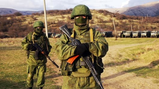 Armed soldiers, identified as Russian forces, pose not far from Simferopol, on March 5, 2014.