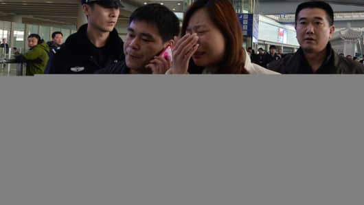 A possible relative cries at the Beijing Airport after news of the missing Malaysia Airlines Boeing 777-200 plane in Beijing on March 8, 2014.