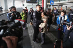 Anxious relatives of passengers onboard Malaysia Airlines flight MH370 at Beijing International Airport in Beijing, China.