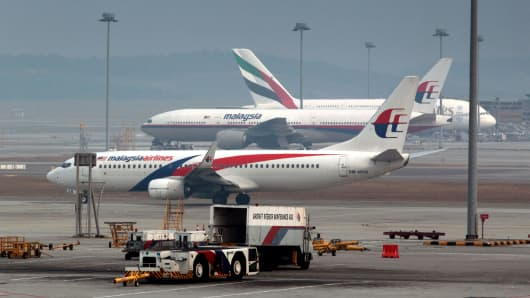 Malaysian Airline System (MAS) aircrafts sit on the tarmac at Kuala Lumpur International Airport (KLIA) in Sepang, Malaysia.