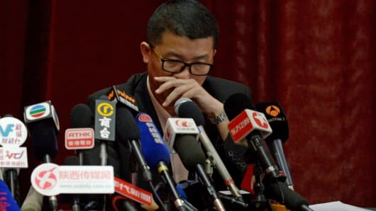 A member of the Malaysia Airlines (MAS) crisis management team, reacts as he prepares to answer a question at a press conference in Beijing on March 9, 2014.