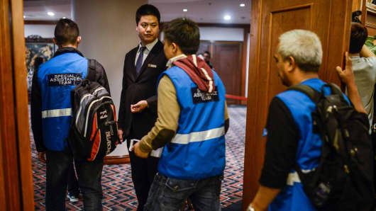 Malaysia Airlines special assistance team members arrive at a hotel where relatives of passengers onboard Malaysia Airlines flight MH370 have gathered in Beijing, China.