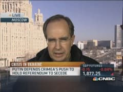 Putin defends Crimea's push to hold referendum