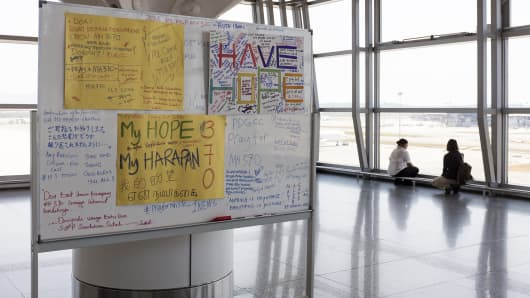 A board with messages for the passengers of missing Malaysian Airline System Bhd. (MAS) Flight 370 stands at Kuala Lumpur International Airport (KLIA) in Sepang, Malaysia, on Tuesday, March 11, 2014.