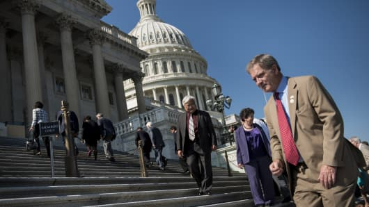 House Democrats walk on the Capitol building's steps.