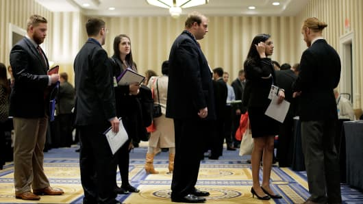 Attendees wait in line to speak with a prospective employer at a job fair on March 8, 2014 in National Harbor, Maryland.