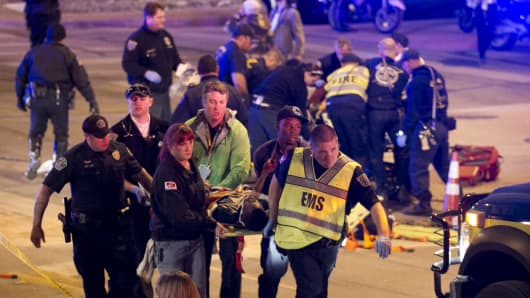 A victim is carried away after being struck by a vehicle in downtown Austin, Texas, during SXSW on Thursday, March 13, 2014.