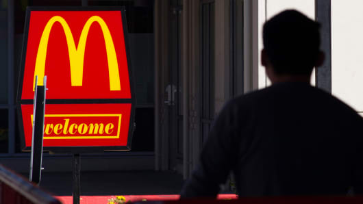 A pedestrian walks past a McDonald's restaurant in San Pablo, California.