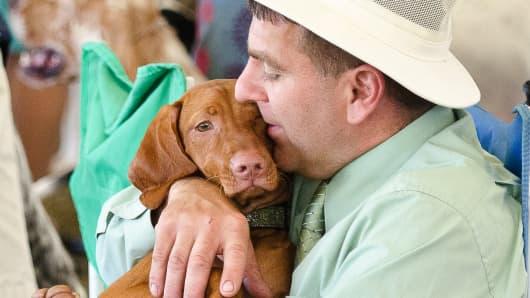 Christopher Arnone of Salt Point, NY, holding one of his Vizsla show dogs, CH Kreeksyde Lady Antonetta of Ayvilon CGC
