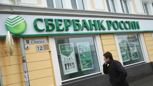 A man walks past a branch of Sberbank Rossii on March 7, 2014 in Simferopol, Ukraine.