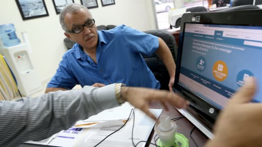 A man enrolls in a health insurance plan under the Affordable Care Act in Miami.