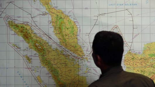 A member of the Indonesian Air Force at Medan city military base inspects the Indonesian military search operation for the missing Malaysian Airlines flight MH370.