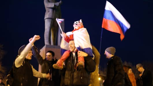 People celebrate in Lenin Square after a day of voting on March 16, 2014 in Simferopol, Ukraine.