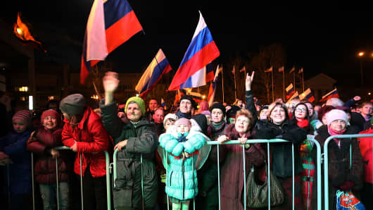 People in Lenin Square attend a pro Russian rally after a day of voting on March 16, 2014 in Simferopol, Ukraine.