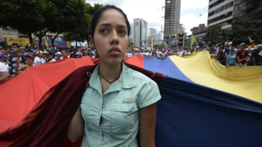 Opposition activists protest near the Cuban Embassy in Caracas, Venezuela, on March 16, 2014.