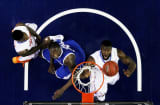Patric Young No. 4 of the Florida Gators and Julius Randle No. 30 of the Kentucky Wildcats vie for a rebound in the second half during the championship game of the 2014 Men's SEC Basketball Tournament in Atlanta.