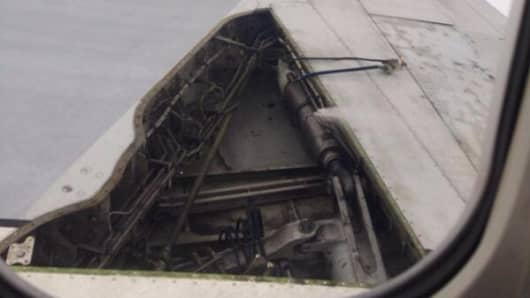 """Broken Delta wing pic posted by reddit user: """"This happened mid-flight..whole plane shook"""""""