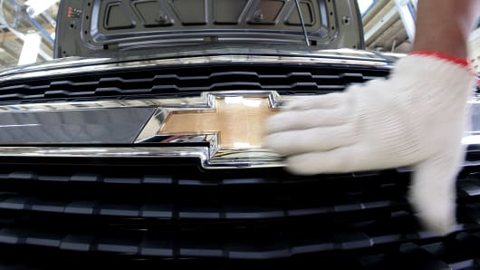 An employee inspects a General Motors Inc. (GM) Chevrolet Spin vehicle on the production line at the PT General Motors Indonesia plant in Bekasi, Indonesia.