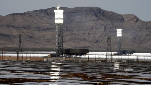 Solar receivers and boilers on top of two towers are reflected in heliostats at the Ivanpah Solar Electric Generating System on March 3, 2014 in the Mojave Desert in California near Primm, Nevada.