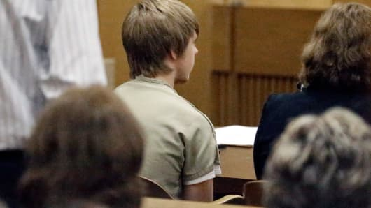 Ethan Couch, center, sits in juvenile court for a hearing about his future Wednesday, Feb. 5, 2014, in Fort Worth, Texas.