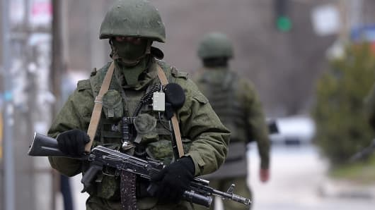 Russian soldiers patrol outside the navy headquarters in Simferopol