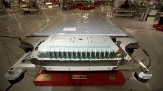 A battery awaits installation in a Model S sedan at Tesla's assembly plant in Fremont, California
