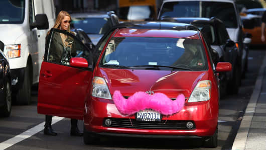 A Lyft customer gets into a car on January 21, 2014 in San Francisco.