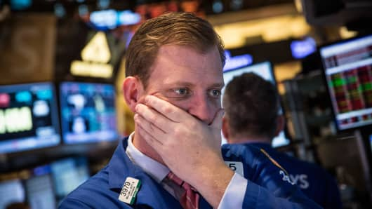 A trader on the floor of the New York Stock Exchange reacts to an announcement from the Federal Reserve during the afternoon of March 19, 2014 in New York City.