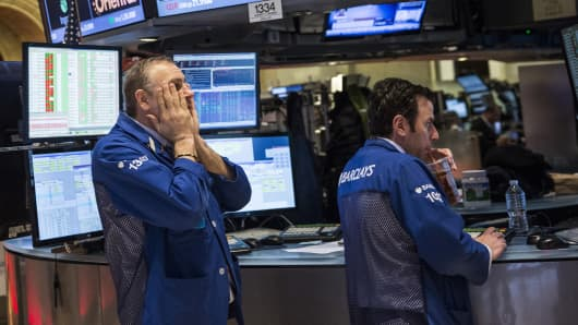 Traders on the floor of the New York Stock Exchange react to an announcement from the Federal Reserve during the afternoon of March 19, 2014 in New York City. The Federal Reserve announced that it would cut bond purchases by $10 Billion.