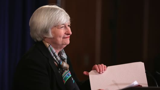 Janet Yellen arrives at her first news conference as Fed chair, March 19, 2014.
