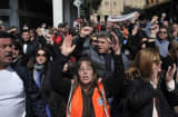 Public sector employees shout slogans during a demonstration against layoffs in Athens