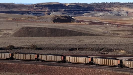 A mile-long train loaded with coal rolls out of the Spring Creek Mine in Montana headed for Detroit.
