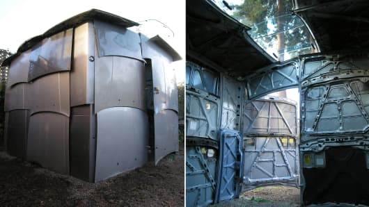 A storage shed made from recycled car parts.
